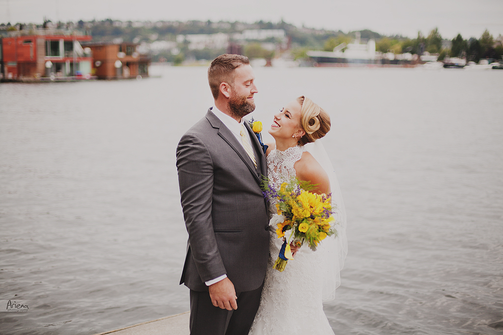 Union Lake summer wedding in boat house. Blue and yellow wedding colors. Badgley Mischka designer wedding shoes