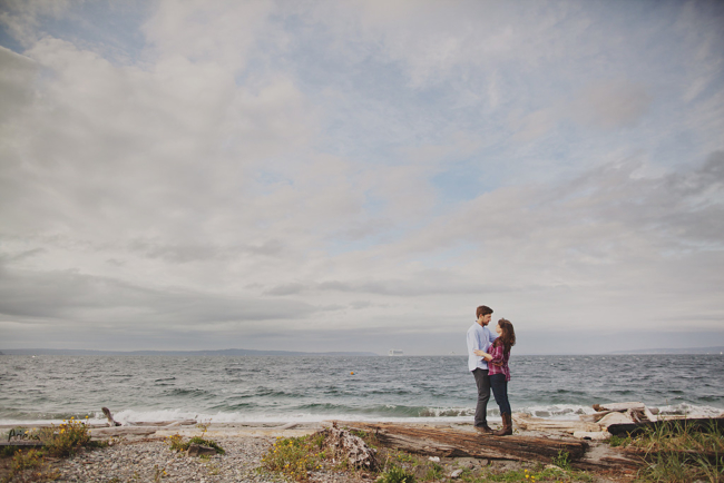 Engagement session at Discovery Park, Seattle. Beautiful lighthouse on background