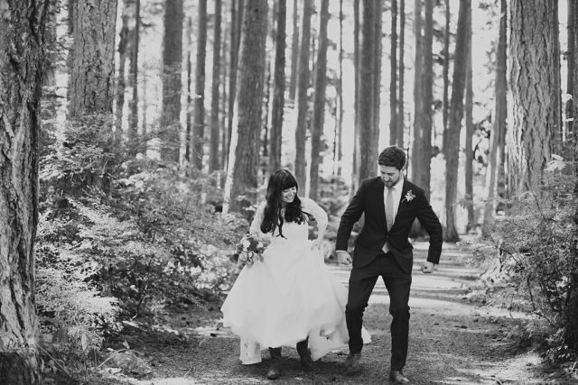 Rustic forest wedding Kitsap Memorial State Park. Sunny summer weather. Bride wearing western boots