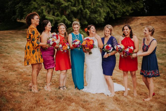 Multicolored rainbow wedding party bridesmaids with bride