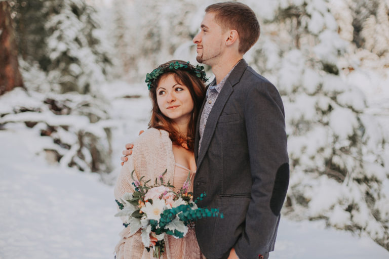 Elopement at Mount Rainier in winter at sunset time. Golden hours and snow in Rocky Mountains