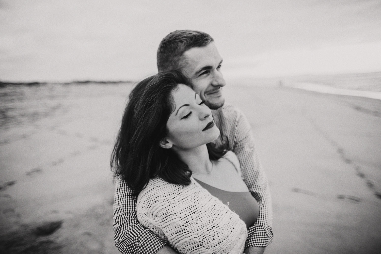 Monterey moody cloudy beach engagement session. California ocean engagement session in red dress