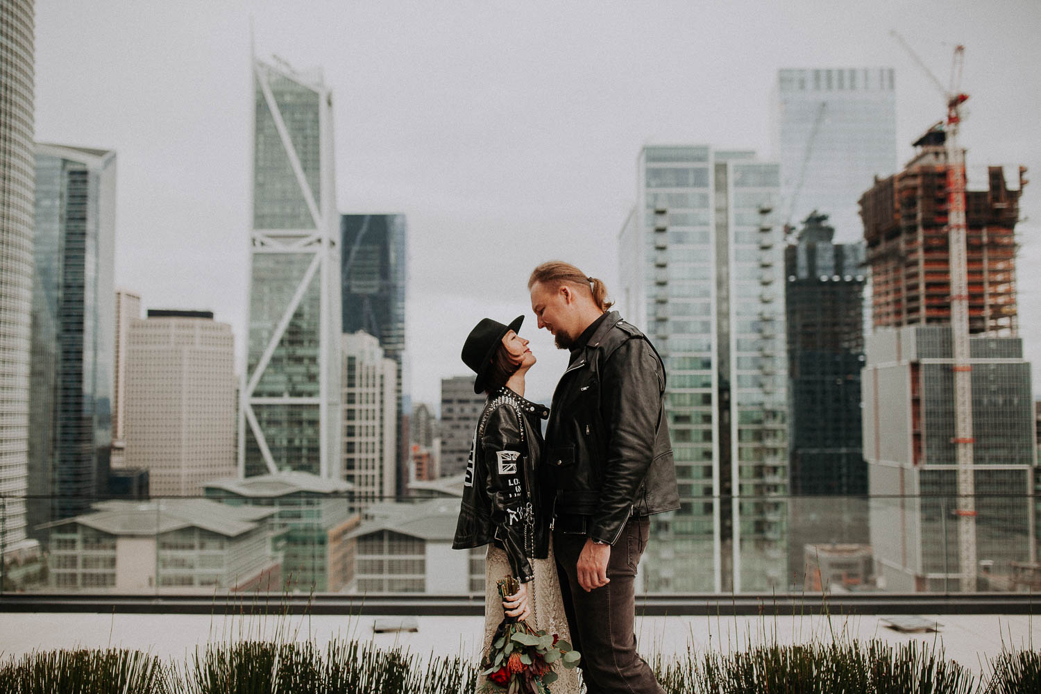 Elopement ceremony in LinkedIn San Francisco office. Rock'n'Roll elopement in San Francisco Downtown. Hard Rock bikers wedding. Leather jackets and biker boots.