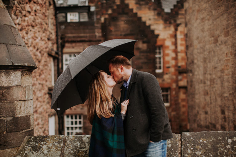 Moody spring engagement session in Old Town of Edinburgh, Scotland. Rainy engagement near Edinburgh Castle