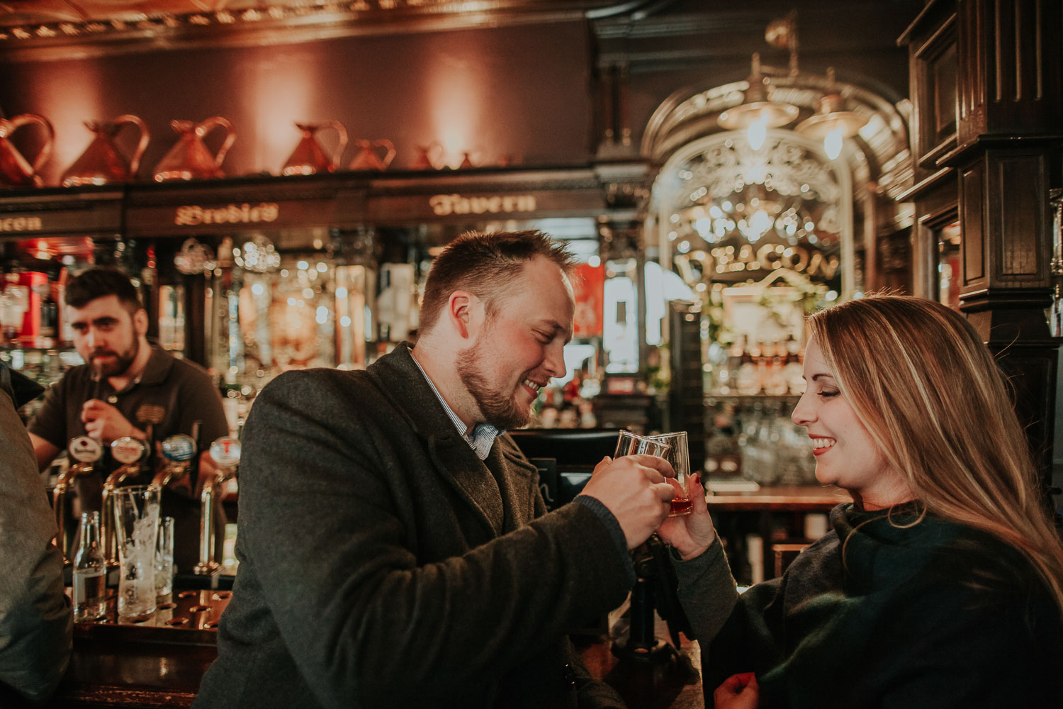 Moody destination spring engagement session in Old Town of Edinburgh, Scotland. Rainy engagement in Deacon Brodie's Tavern by destination photographer