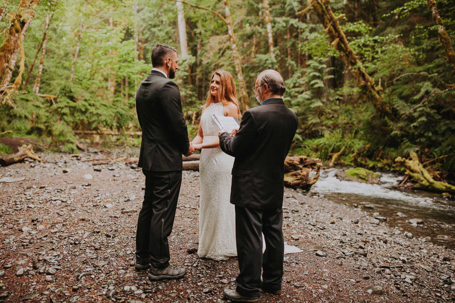 Lake Crescent rainy elopement at Olympic Peninsula. Rain forest intimate ceremony. Hiking to elope at Merymere Falls